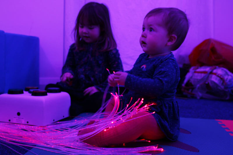 Molly and Phoebe play with fibre optic lights