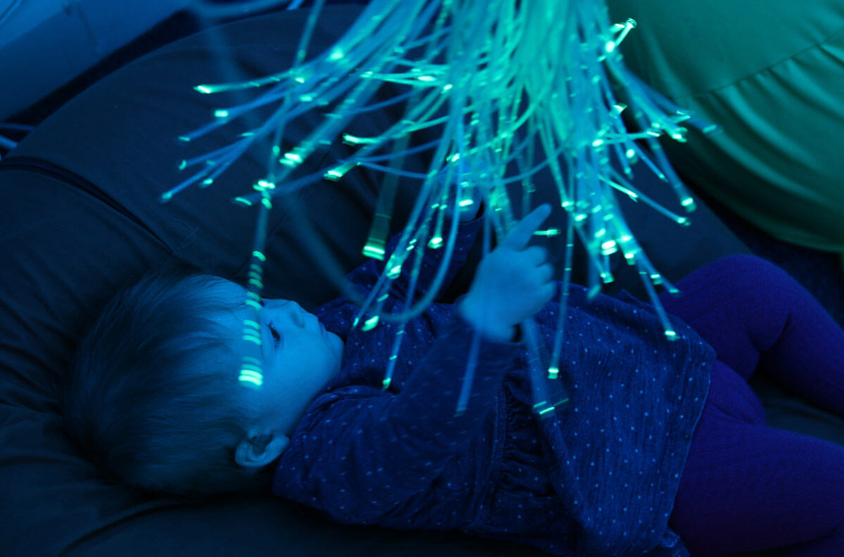 Molly plays with a fibre optic chandelier